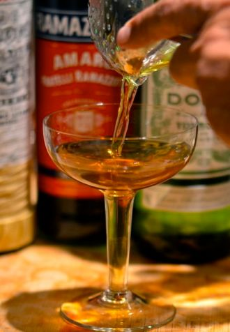 Pouring a Brooklyn cocktail.