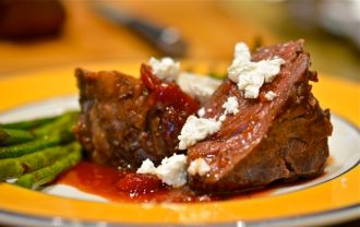 Venison Loin With Cherry Cumberland Sauce and Goat Cheese.